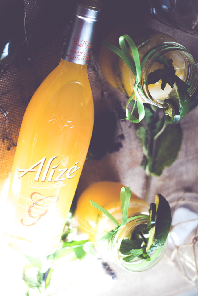 This Jalapeno Mango Mojioto is a sweet yet spicy cocktail guaranteed to be the hit at your next get together. #alizeincolor